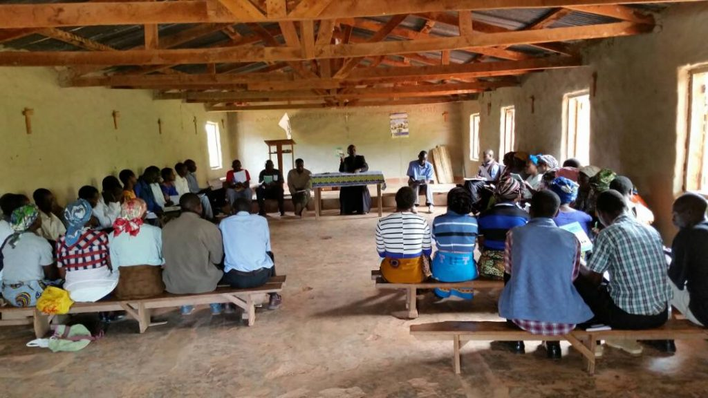 Father Silungwe giving instruction to Sunday school instructors from Mughese Zone
