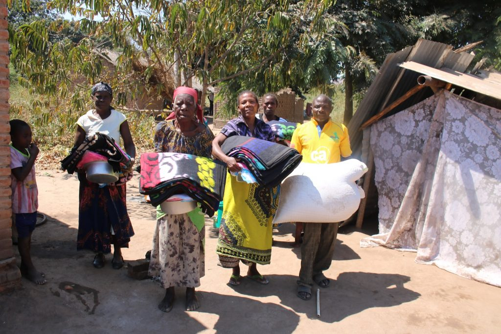 Some of the beneficiaries carrying the items they received