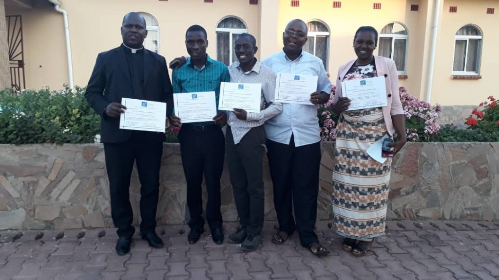 The five delegates from Karonga Diocese displaying their certificates