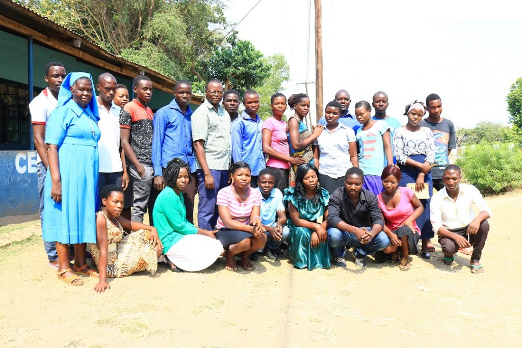 Young people participating in the training with Father Sikwese (in specs) and Sr Beatrice Chipeta (in blue habit) after the launch