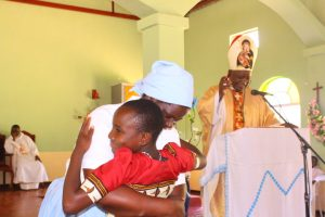 Caroline Banda being welcomed by the Headmistress of St Mary's Girls Mrs Martha Nyondo