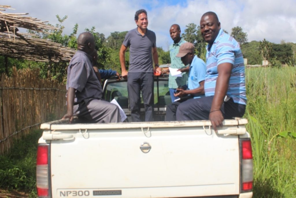 Keith and Fr Bundi were happy to be at the back of the vehicle enjoying the cool weather of Chipunga Farm