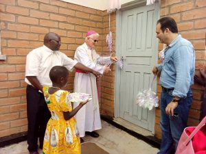 Bishop Ryan Cutting a Ribbon Marking the Official Opening of the Clinic