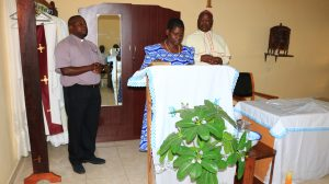 Mrs Martha Nyondo (one of lay members of the Review Board of the Diocese) being sworn in (with the Bishop and the Judicial Vicar on her sides)